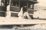 Ladies on the steps of the Stewart House, Seward, Alaska, ca. 1905-1915.