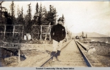 Man standing on railroad tracks, Seward, Alaska, ca. 1905-1915.