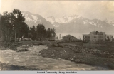 Creek running through early Seward, Alaska, ca 1905-1915.