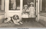 Two girls and a dog, ca. 1905-1910.