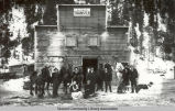 Group photo in front of the Alaska Transfer Company, ca. 1910.