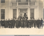 Group portrait in front of the office building, Seward, Alaska, ca. 1905-1915.