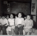 Four students with books, ca. 1946-1955.