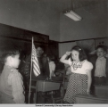 Saluting the flag, ca. 1946-1955.