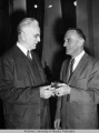 Ralph Rivers presents John McCormack with a letter opener