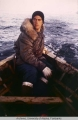 Don Foote in a skin boat with an outboard motor