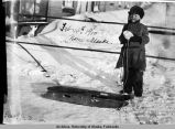 Child with a sled.