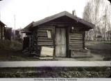 This log cabin was on Cushman and 11th Streets.