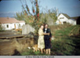 Blurred image of two woman and a dog.