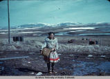 Native Alaskan girl by railroad tracks.