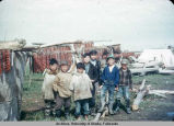 Hooper Bay children drying fish.