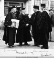 Four men in mortar boards and robes