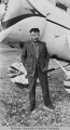Wiley Post poses for a photograph with the plane Winnie Mae