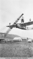 Crane lifts a Ptarmigan Airline plane