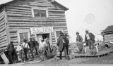 Men outside a saloon, Dishkaket, Alaska