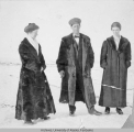 Three people photographed at Ruby, Alaska during winter