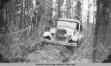 A.R.C. Ford 228 stuck in [illegible] Detour, Mile 0.5 Deadwood Road, Sept. 20, 1930.