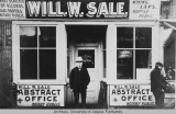 Man stands outside William W. Sale's abstract office