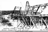 Setting steel, Salatna bridge driver converted into derrick. Nov. 21, 1936.