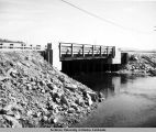 Moose Creek Bridge. Looking upstream. May 1954.