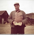 Bob Bartlett holding a gold brick