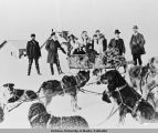 Group of people with sled dog team.