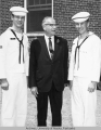 Bob Bartlett poses with two Coast Guard Cadets