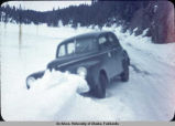 Car stuck in snowbank.