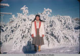 Native Alaskan girl standing in snow.