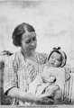 Mrs A. P. Cook holding a baby