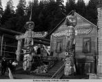 Totem poles in a wood village.