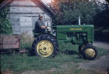 Man on John Deere tractor.