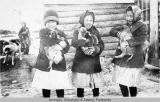 Three girls holding puppies