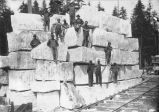 Men on marble blocks.