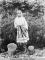 Young Eskimo girl with blue berries
