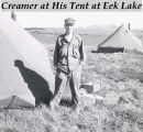 Creamer at his tent at Eek Lake.