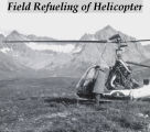 Field refueling of helicopter.