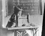 Child with a sewing machine.