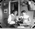 Cora Rivenburg learning the hand sewing machine