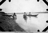 Men in birch bark canoes