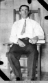 Lawyer Rivenburg seated in a chair