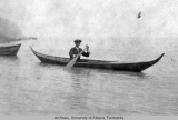 Lawyer Rivenburg in a birch bark canoe
