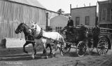 Horse-drawn wagon.
