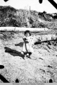 Indian girl playing on the bank of the Yukon River