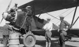 Men refueling an airplane.