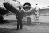 Joe Crosson in front of an airplane.