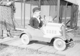 Joe Crosson, Jr. with toy car.