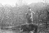 Wiley Post with a dead bear.