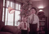 Boys in front of Christmas tree.