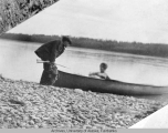 Mr. & Mrs. Rice traveling by canoe